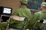 Elderly prisoners singing karaoke songs in an indoor recreational room, in Onomichi prison, Japan.  Monday, May 19th 2008