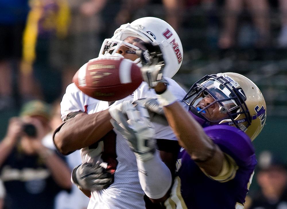 JMU free safety Marcus Haywood breaks up a pass to UMass wide receiver Victor Cruz during Saturday's game against UMass at Bridgeforth Stadium in Harrisonburg.