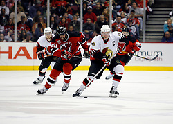April 28, 2007; East Rutherford, NJ, USA; Ottawa Senators right wing Daniel Alfredsson (11) skates by New Jersey Devils left wing Jay Pandolfo (20) during the second period of game two of the 2007 NHL Eastern Conference semi-finals at Continental Airlines Arena in East Rutherford, NJ.