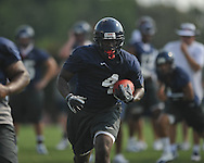 Ole Miss' Nicholas Parker (4) runs during football practice in Oxford, Miss. on Sunday, August 7, 2011.