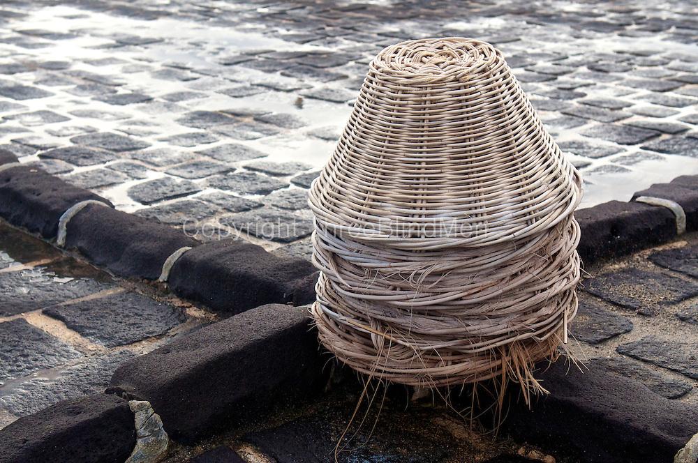Baskets for collecting salt at a salt pan.
