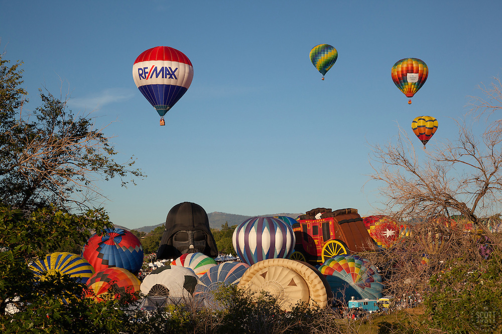"""""""Great Reno Balloon Race 9"""" - Photograph of hot air balloons lifting off during the mass ascension at the 2012 Great Reno Balloon Race."""