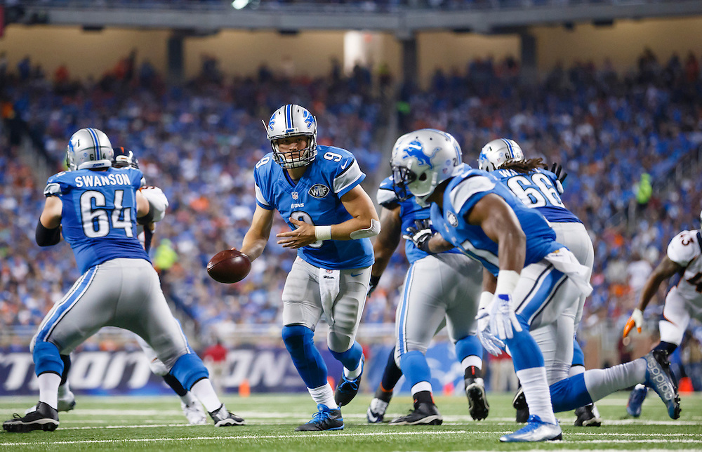 Detroit Lions quarterback Matthew Stafford (9) gets set to handoff against the Denver Broncos during an NFL football game at Ford Field in Detroit, Sunday, Sept. 27, 2015. (AP Photo/Rick Osentoski)