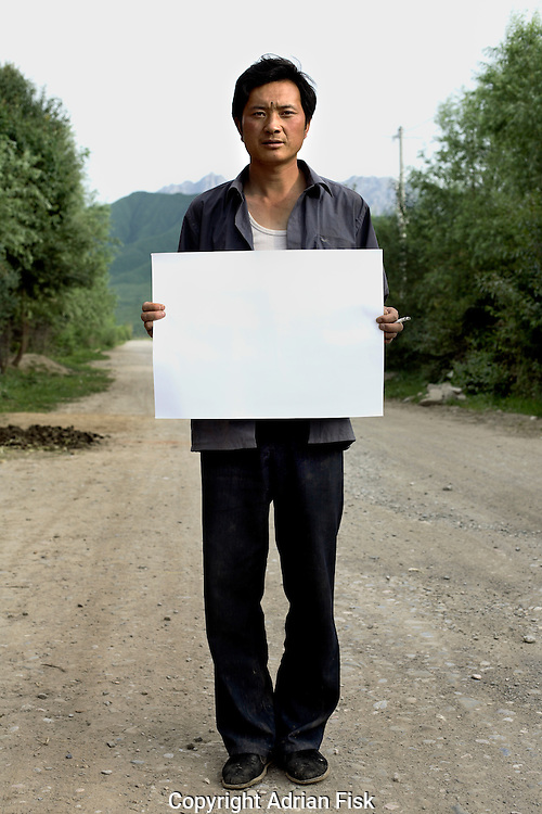Yang Long Long - 30 Yrs.<br /> Farmer.<br /> Gansu Province.<br /> <br /> (Illiterate) 'When I go to the big city I feel like I don't know anything'.