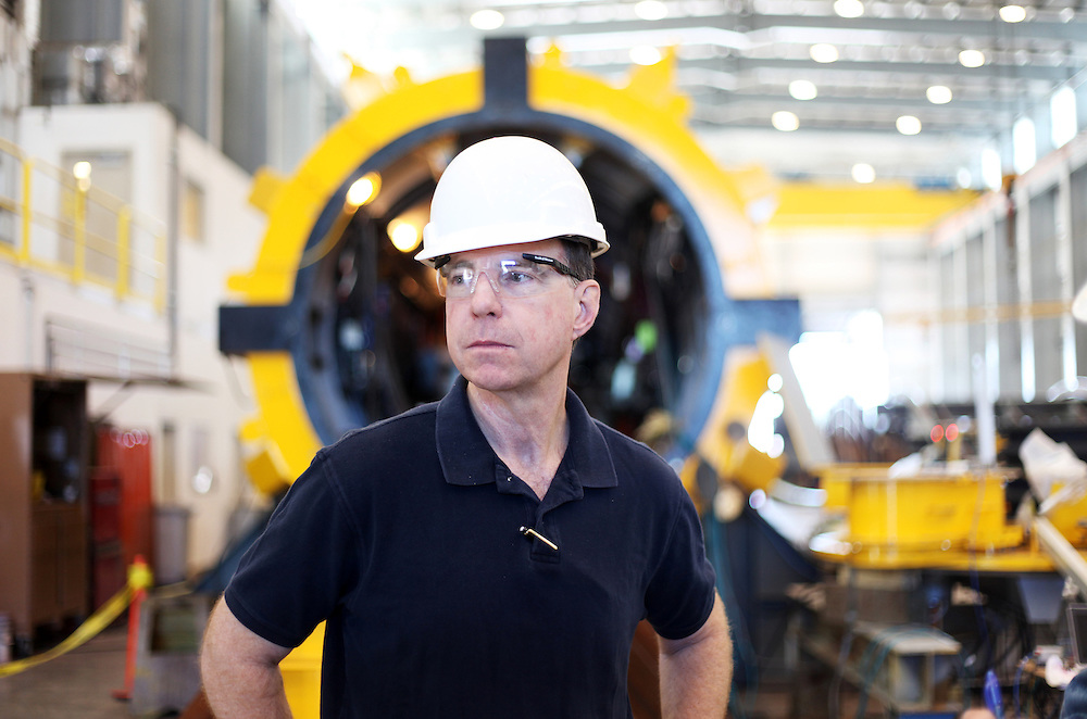 Michael Kelly of Ocean Power Technologies. In the first commercially licensed project for generating electricity from ocean wave action, a 103-foot-long, 220-ton buoy soon to be deployed off the coast of Oregon will provide 150 kilowatts of power. The buoy, nearly completed, undergoes tests at an Oregon Iron Works facility in Vancouver Wash.