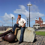 UK. Liverpool. Professional 'Streaker' Mark Roberts round the corner from Liverpool Docks..Photo©Steve Forrest/Workers' Photos.