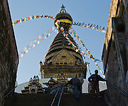 """A long stairway ascends to Buddhist Swayambhunath, the """"Monkey Temple"""", which was founded about 500 AD, one of the oldest and holiest Buddhist sites in the Kathmandu Valley. It sits on a hill in the west of Kathmandu overlooking the city in Nepal, Asia."""