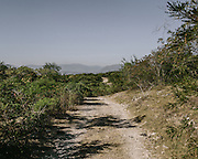 This road leads to the Cocula dump where the remains of one of the 43 students was found. The areas next to it were littered with trash and clothing presumed to belong to kidnapped individuals.