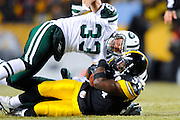 PITTSBURGH, PA - JANUARY 23: Rashard Mendenhall #34 of the Pittsburgh Steelers is tackled by Eric Smith #33 of the New York Jets in the AFC Championship Playoff Game at Heinz Field on January 23, 2011 in Pittsburgh, Pennsylvania(Photo by: Rob Tringali) *** Local Caption *** Rashard Mendenhall;Eric Smith