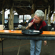 May 12, 2003 - Lleanne Hazard brushes her teeth in the community room at Dignity Village in Portland, OR. She is 1 of 65 homeless people who have taken up residence on the leaf recycling land near the airport with the city's permission. They are being asked to leave again by October.