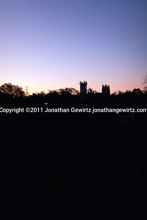 Silhouette of the two towers of the National Cathedral in Washington, DC at dawn. Scaffolding on one of the towers is for repairs following the earthquake of August 23, 2011. WATERMARKS WILL NOT APPEAR ON PRINTS OR LICENSED IMAGES.