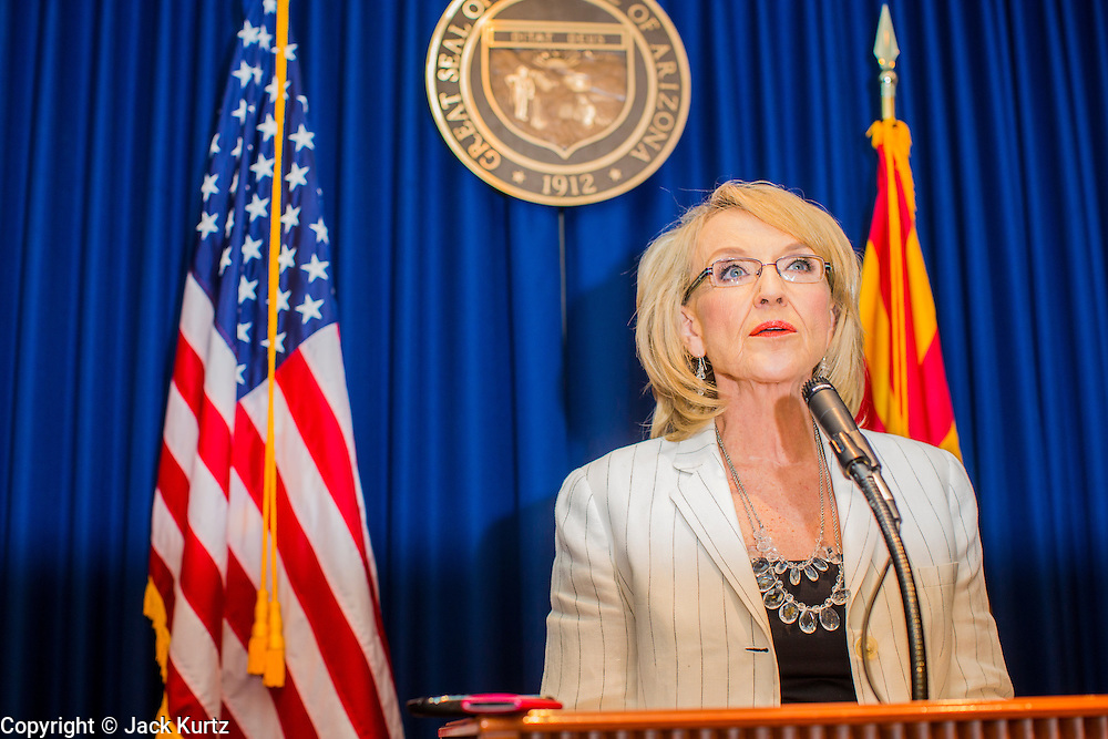 25 JUNE 2012 - PHOENIX, AZ:  Arizona Governor JAN BREWER responds to the US Supreme Court ruling that overturned most of SB 1070, the state's tough anti-immigration bill, duing a press conference Monday. Brewer said the state won a major victory in the court's ruling because a narrow portion of the law was allowed to stand. The lawsuit, US v. Arizona, determines whether or not Arizona's tough anti-immigration law, popularly known as SB1070 is constitutional. The court struck down most of the law but left one section standing, the section authorizing local police agencies to check the immigration status of people they come into contact with.      PHOTO BY JACK KURTZ