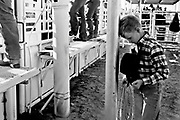 Carl Sweazea, 10 of Mountainair NM bows his head during the convocation at the High Plains Junior Rodeo Association Finals in Clovis, NM.