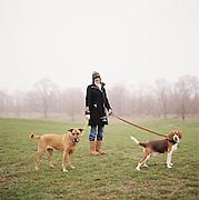 Lady walking her dogs in Prospect Park in Brooklyn, New York. 2011
