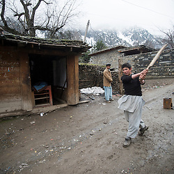 Bumburet, Chitral District,Pakistan.Pic Shows Kalash boys in the Kalash village in the valley of Bumburet playing cricket