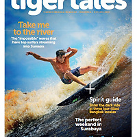 Mikey Barber surfing the Bono river wave in Sumatra 2012. Tiger Tales inflight magazine cover October 2013