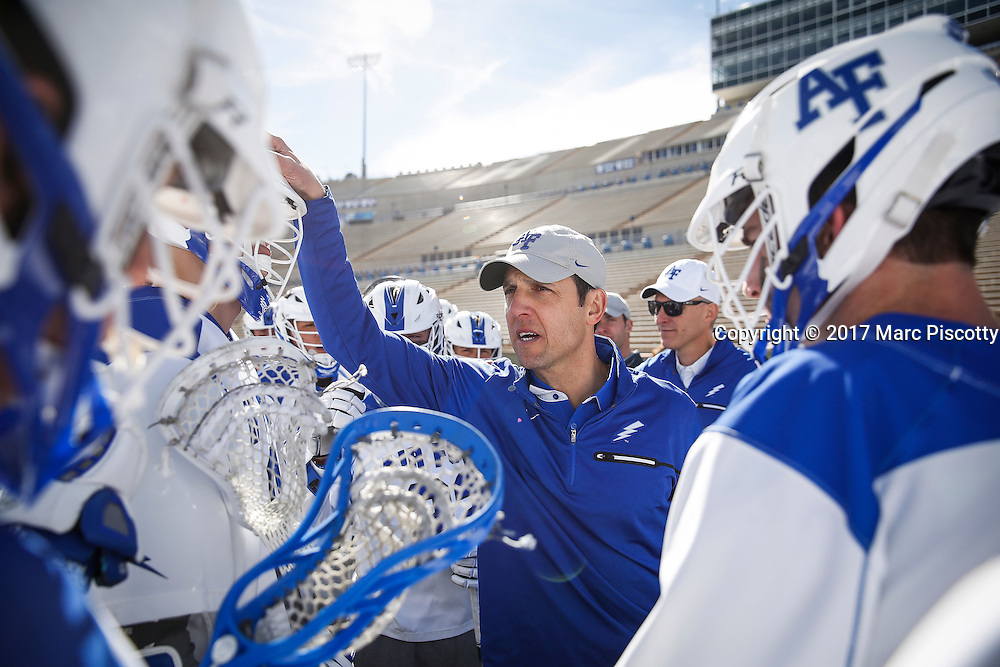 SHOT 2/18/17 2:40:43 PM - Air Force head lacrosse coach Eric Seremet huddles up with his his team after losing to Marist College at Falcon Stadium at the Air Force Academy in Colorado Springs, Co. Marist won the game 10-4. Seremet is in his ninth season as the head coach for the Air Force lacrosse program.<br /> (Photo by Marc Piscotty / &copy; 2017)