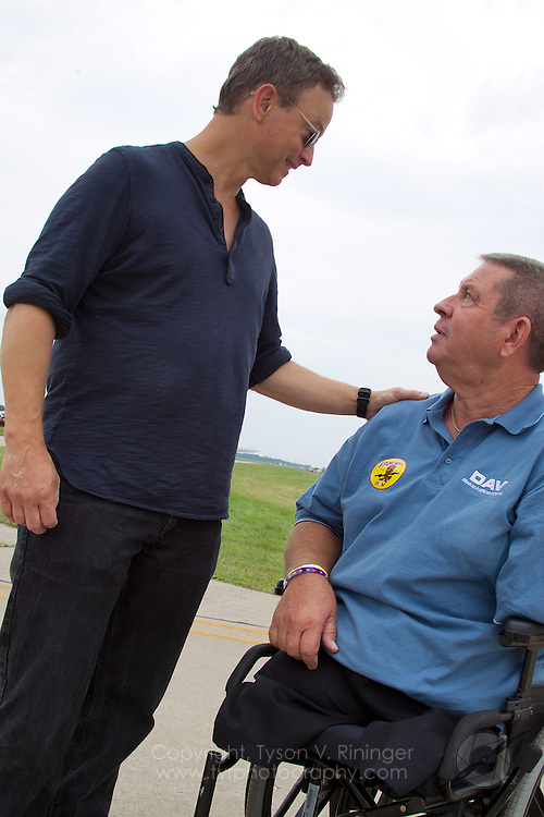 Actor Gary Sinise with Vietnam Veteran and triple-amputee, Jim Sursely..Disabled American Veterans Parade activities involving Vietnam Veteran and triple-amputee, Jim Sursely, B-25 'Panchito' owner and pilot, Larry Kelley and actor Gary Sinise.