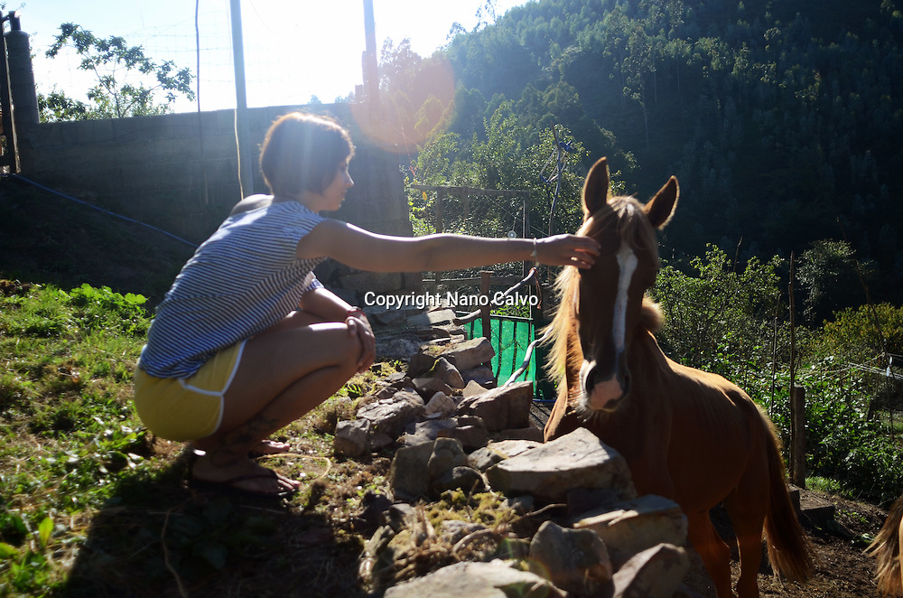 Young woman interacting with horse