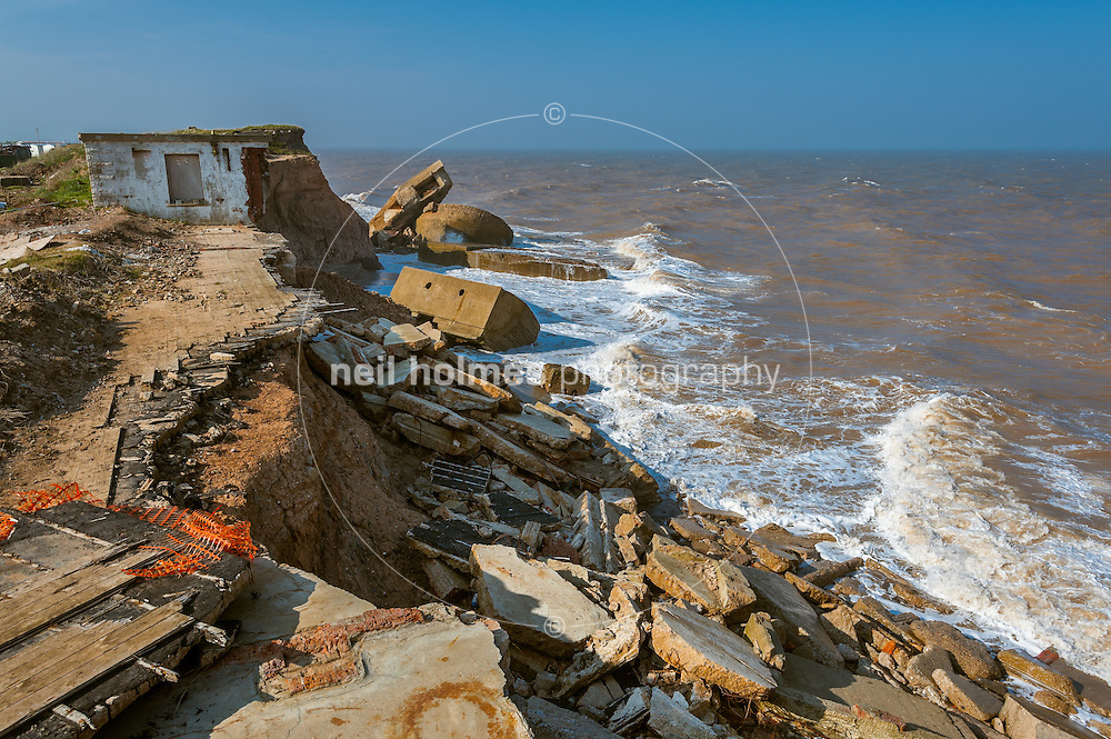Kilnsea is situated on the Holderness coast, East Yorkshire, a few miles from Withernsea to the north and spurn point (head) to the south. This part of the coast is the fastest eroding coastline in the UK, the clay cliffs are eroding at an average of 2.1 meters a year...Image shows collapsed gun emplacements and other military steel re-enforced concrete structures falling into the north sea.