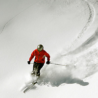 A skier enjoys the bounty of a recent storm at Snowmass Ski area.