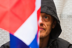 Whitehall, London, April 4th 2015. As PEGIDA UK holds a poorly attended rally on Whitehall, scores of police are called in to contain counter protesters from various London anti-fascist movements. PICTURED: One of the few PEGIDA supporters waits for their rally to begin.