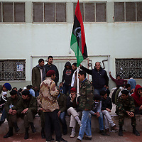 Young men wait to  sign up to fight for Free Libya's new army in Banghazi on March 2, 2011.