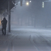 A pedestrian walking down E. Main St. during a storm Friday, Jan, 22, 2016 in Newark.<br /> <br /> A massive blizzard dumps snow in Newark, and eastern United States on Friday, with mass flight cancellations, five states declaring states of emergency.