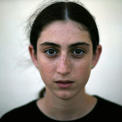 """Rachel Gross, 14, a resident of the Gush Katif settlements, is seen in Gaza, Palestinian Territories, Nov. 4, 2004.  When asked her thoughts about leaving the settlements she responded, """"I want to stay here. I love this place very much. If someone has a problem, everyone helps. Happiness, sadness, we are together."""" Israel's parliament recently supported compensation payments for Jewish settlers leaving the Gaza Strip, in a vital vote for Prime Minister Ariel Sharon's plan to evacuate the occupied territory."""