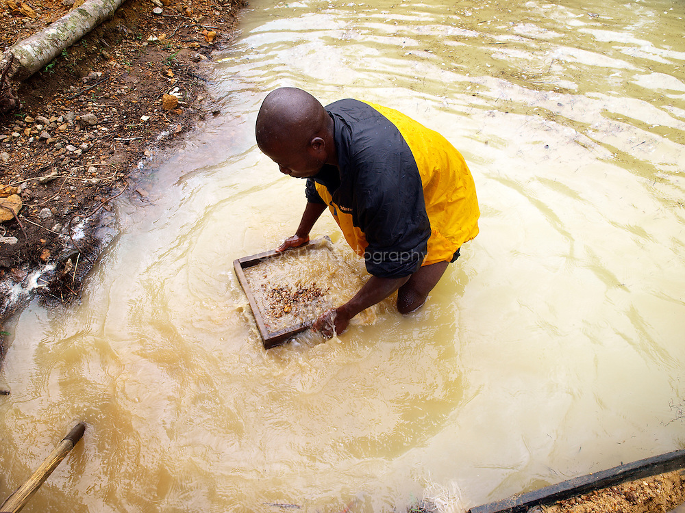 A miner searching for diamonds and gold, Manamu, Kingsville, Liberia.