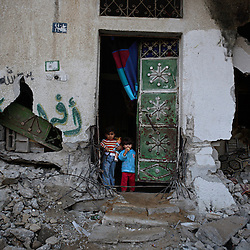 Palestinian children are seen in front of their home, which was damaged by Israeli airstrikes intended to target militants, Beit Hanoun, Gaza Strip, Palestinian Territories, Nov. 16, 2006. According to Human Rights Watch, since September 2005, Israel has fired about 15,000 rounds at Gaza while Palestinian militants have fired around 1,700 back.