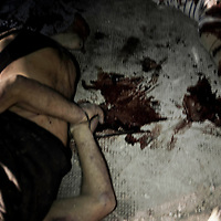 SYRIA, ALEPPO. The bodies of three man (one of them handcuffed) have been found by rebels in the northern outskirts of Aleppo on September 25, 2012. Rebels claim those are civilians tortured and killed by regime forces. ALESSIO ROMENZI