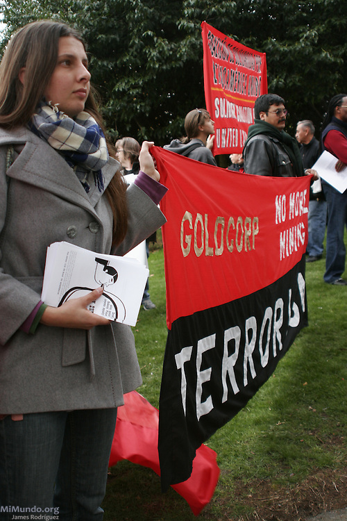 """Independent journalist and activist Dawn Paley (left) and Mario Tema from Sipakapa, Guatemala, hold a banner that reads: """"Goldcorp: No more mining terrorism!"""" The activists protested Goldcorp's open pit gold mining operations in Central America during the annual May Day march. Vancouver, BC, Canada. May 1, 2007."""