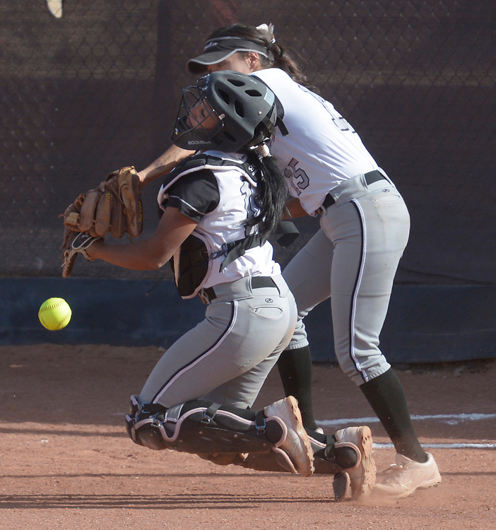 gbs040617o/SPORTS -- Volcano Vista's first baseman Samantha Trujillo, 15, and catcher Akia Marshall tangle after a foul ball during the game at Cibola on Thursday, April 6, 2017. (Greg Sorber/Albuquerque Journal)