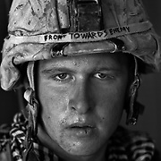 "U.S. Marine Lcpl. Damon ""Commie"" Connell age 20 who is part of Alpha Company of the 24th Marine Expeditionary Unit (MEU) Battle Landing Team (BLT) 1/6, after a patrol in Garmsir District, Helmand Province, Afghanistan at Forward Operating Base Apache North. Located in Southern Helmand Province, Garmsir has been a haven for insurgents for the last several years. Earlier this year the Marines cleared the area after a period of heavy fighting. Damon is from Las Vegas NV and this is his first tour of Afghanistan."
