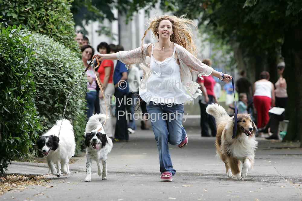 "15/8/2005.CANINES ARE A GIRL'S BEST FRIEND!!!..Actress Lisa Lambe out for an amble with her doggy friends, gets some canine advice in advance of her role in ""Dog Show"" opening tomorrow night at the Watergate Theatre, Kilkenny (Tues 16) as part of the Kilkenny Arts Festival..Pictured with Lisa are from left Molly, Daisy and Rebel..Picture Dylan Vaughan."