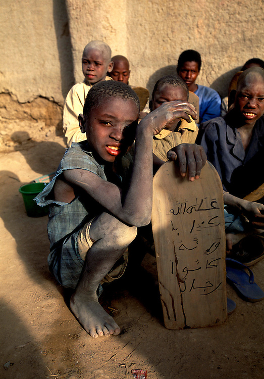 Djenne, Mali. open air Madrassa with traditional writing tablet