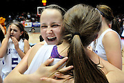 gbs030912q/SPORTS/Greg Sorber --  Elida's Kayla Summers, left, hugs teammate Tayler Fraze after they won the B Girls State Championship in the Pit on Friday, March 9, 2012. Elida overcame Corona 59-41.
