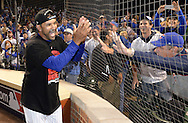 CHICAGO, IL - OCTOBER 12:  Bench Coach Dave Martinez #4 of the Chicago Cubs celebrates with fans after Game 3 of the NLDS against the St. Louis Cardinals at Wrigley Field on Monday, October 12, 2015 in Chicago , Illinois. (Photo by Ron Vesely/MLB Photos via Getty Images) *** Local Caption *** Dave Martinez