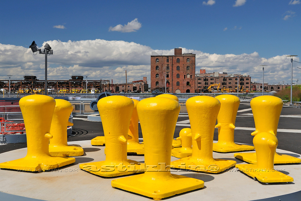 Yellow bollards and blue sky
