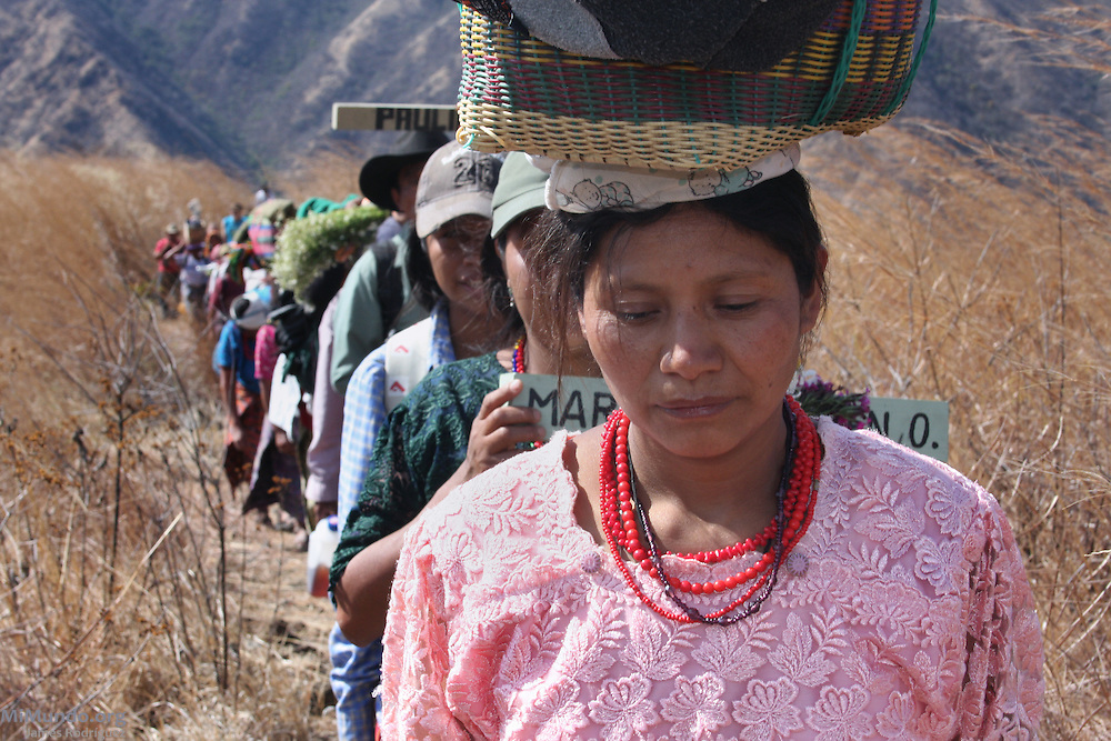 Dozens hike up to commemorate the twenty-seventh anniversary of the Rio Negro Massacre at Pak'oxom Peak. On March 13, 1982, the Guatemalan army and civil patrolmen from neighboring Xococ rounded up residents of Rio Negro, marched them uphill to Pak'oxom, and brutally raped and massacred 177 women and children. Nearly 400 community members of Rio Negro were killed in four separate massacres in the early 1980's due to the community's resistance to give up their lands and make way for the Chixoy hydroelectric project. Rio Negro, Rabinal, Baja Verapaz, Guatemala. March 13, 2009.