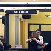 """DENVER - FEBRUARY 26:  Rocky Mountain News editor, publisher and president John Temple (right) hugs Judy DeHaas (left), a staff photographer at the paper, in the newsroom. The Rocky Mountain News, one of two of Denver's daily newspapers, announced Thursday February 26, 2009 that tomorrow's edition would be the final one of the newspaper's almost 150 years of publishing. The newspaper had been put up for sale by its owner, E.W. Scripps, but the search for a buyer proved unsuccessful. """"Denver can't support two newspapers any longer,"""" Scripps CEO Rich Boehne told staffers, some of whom cried at the news. """"It's certainly not good news for you, and it's certainly not good news for Denver."""" The Rocky was founded in 1859 by William Byers, one of the most influential figures in Colorado history. Scripps bought the paper in 1926 and immediately began a newspaper war with The Post. That fight ebbed and flowed over the course of the rest of the 20th century, culminating in penny-a-day subscriptions in the late '90s. The closure will cost 228 newsroom employees their jobs..(Photo by Marc Piscotty/ © 2009)"""