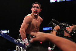 Oct 19, 2012; Brooklyn, NY, USA; WBC/WBA super lightweight champion Danny Garcia celebrates his 4th round KO win over Erik Morales at the Barclays Center.