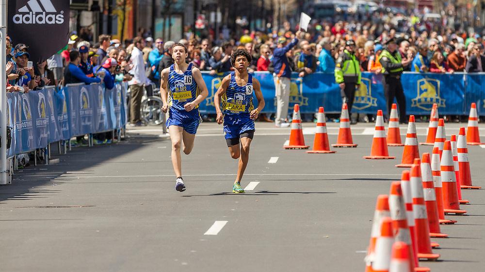 BAA Invitational Road Mile, Middle School 1000m, winner Jovan Talavera leads Joel Lara