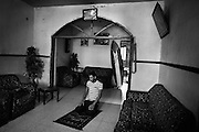 Ali Ayrhim, 18, prays in his home before going surfing, in Gaza City, Gaza Strip. Exiting Gaza is a difficult process, especially for males aged 18-40, so surfing offers and important release for those who practise the sport.