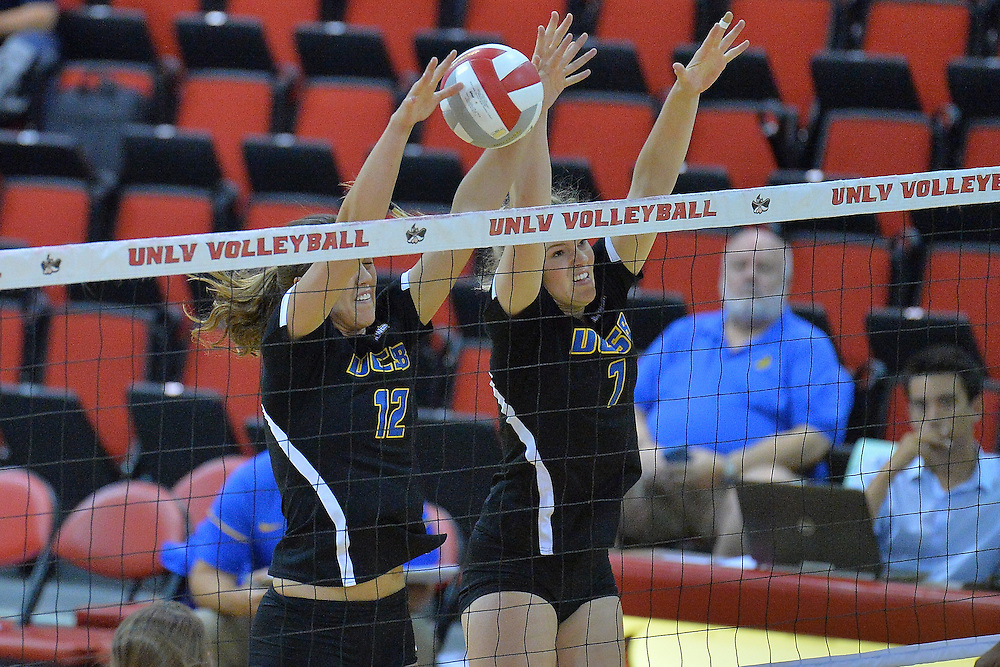 August 26, 2016; Las Vegas, Nev.; UC Santa Barbara middle blocker Phoebe Grunt (12) and UC Santa Barbara outside hitter Megan Rice (7) go up for a block attempt during a match between the UNLV Lady Rebels and UC Santa Barbara Gauchos. UNLV defeated UCSB 3-0.