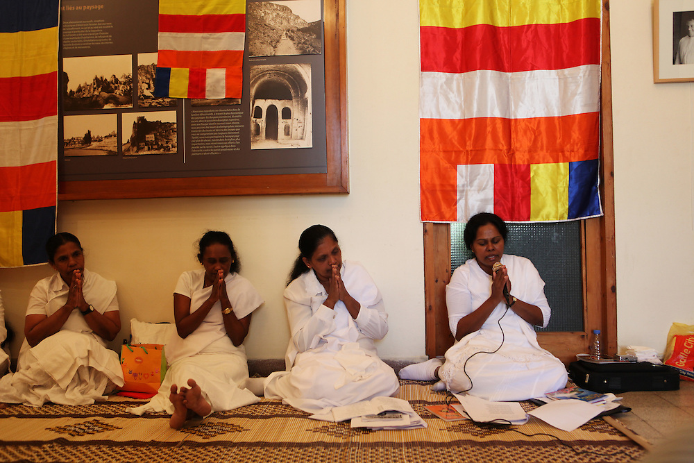 Sri Lankan Buddhists set up an impromptu place of worship in a church's library to pray on Sunday.