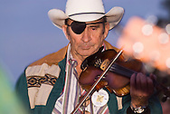 Cowboy fiddler Dean Essex with eye patch, Montana Old Time Fiddlers Picnic, Livingston Montana
