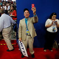 A delegate snaps a cell phone photo at the Republican National Convention.