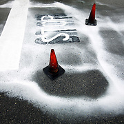 Rain causes wet paint to run in the street